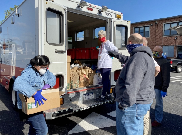 St. John's Celebrates May Day with Gifts of Food to Neighbors